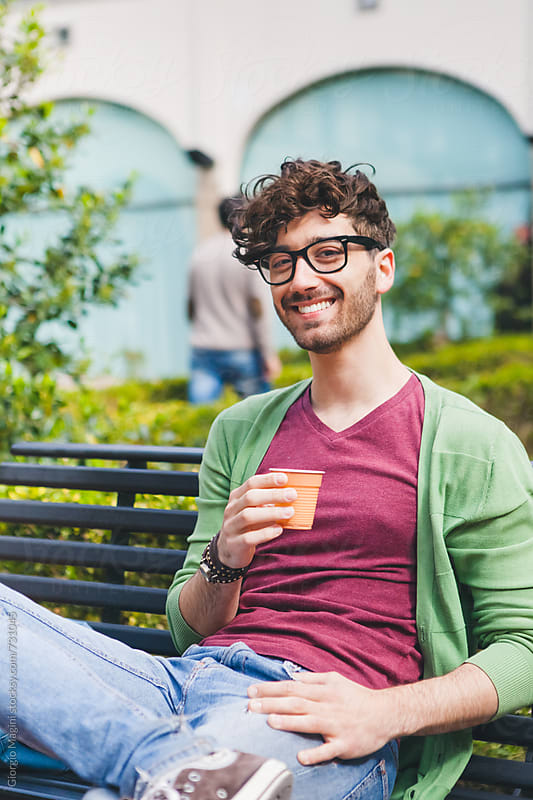 College Student Having an Espresso Coffee in the Courtyard of the Campus by Giorgio Magini for Stocksy United