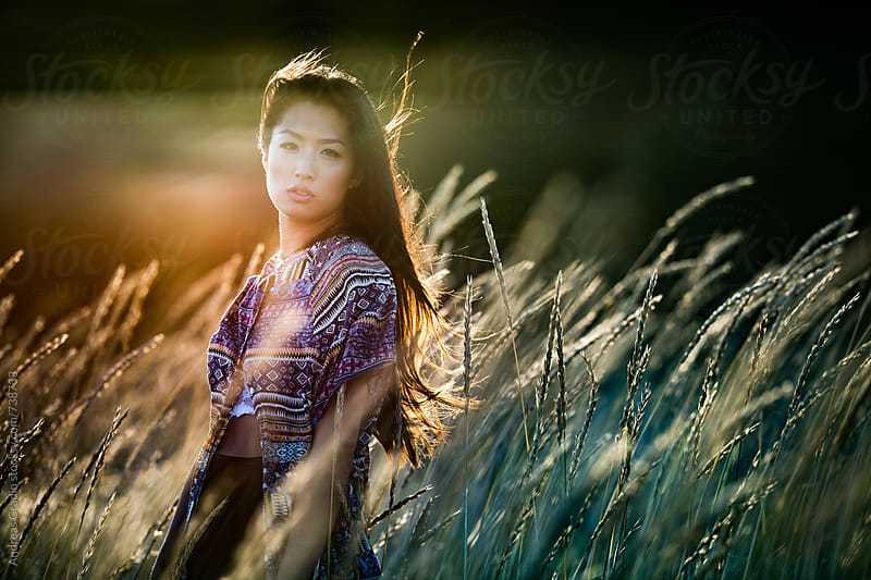 asian beach girl by Andreas Gradin for Stocksy United