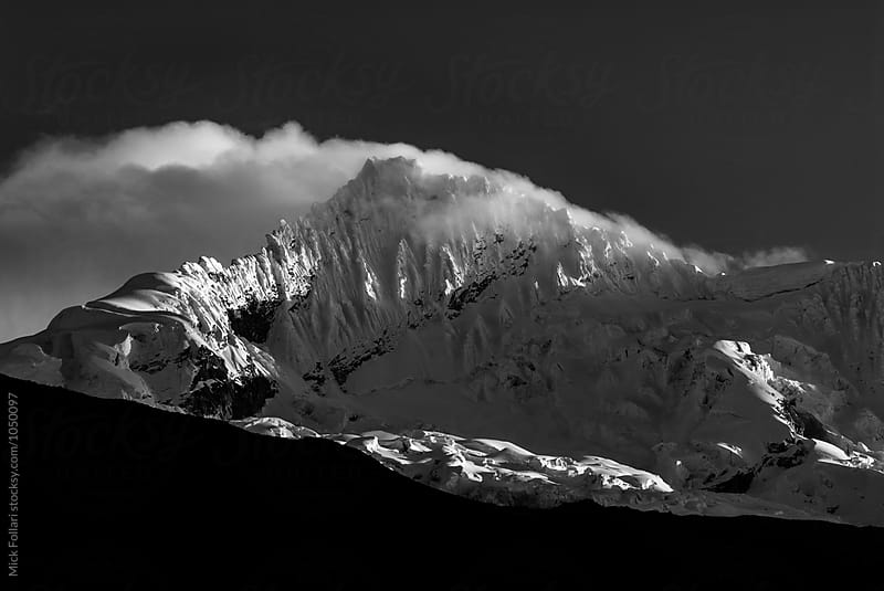 Clounds blowing across mountaim summit by Mick Follari for Stocksy United
