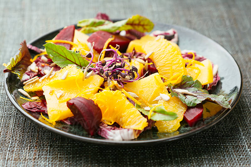 Sweet Sour Salad with Beets, Rutabaga and Oranges by Harald Walker for Stocksy United