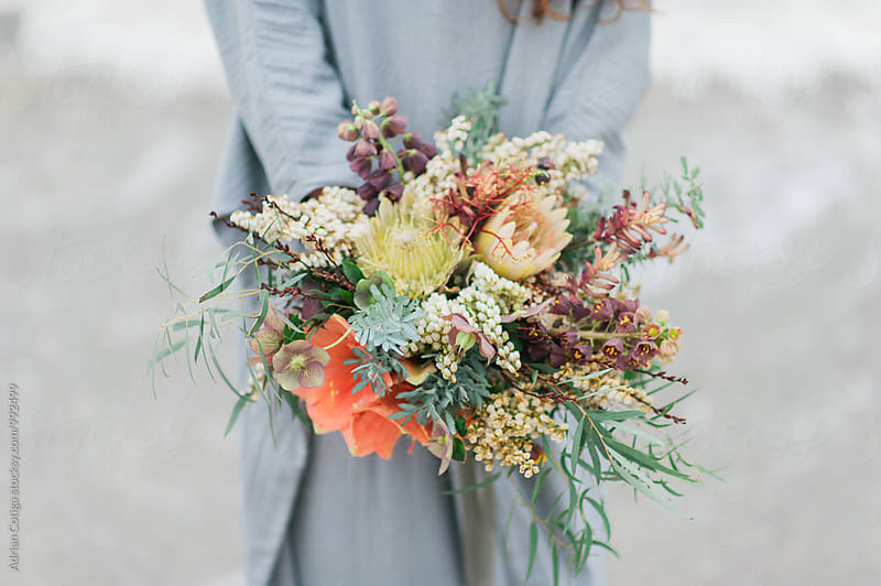 Bohemian flowers bouquet by Adrian Cotiga for Stocksy United