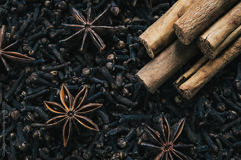 Christmas Spices, Cinnamon and Star Anise on a Bed of Cloves by Claudia Lommel for Stocksy United