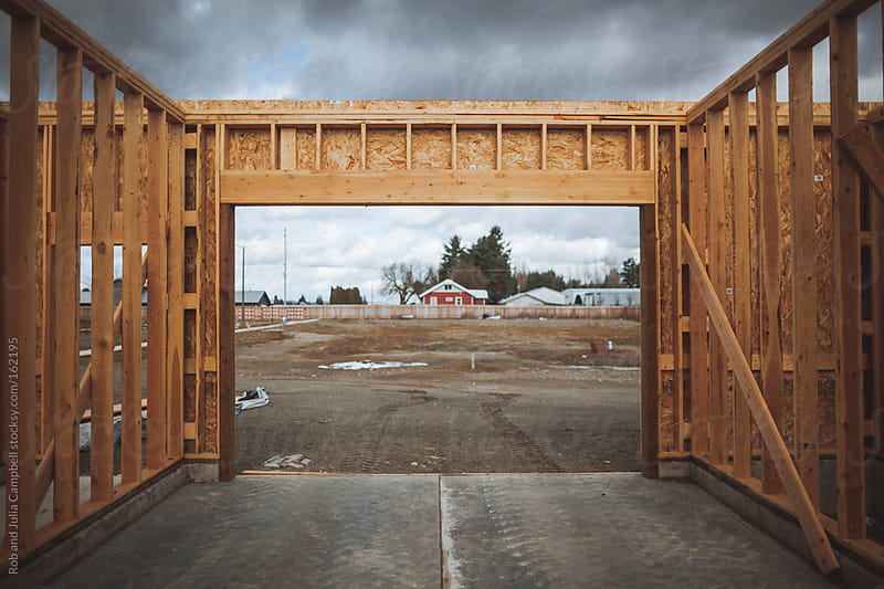 Detail of framed wall and door at construction site by Rob and Julia Campbell for Stocksy United