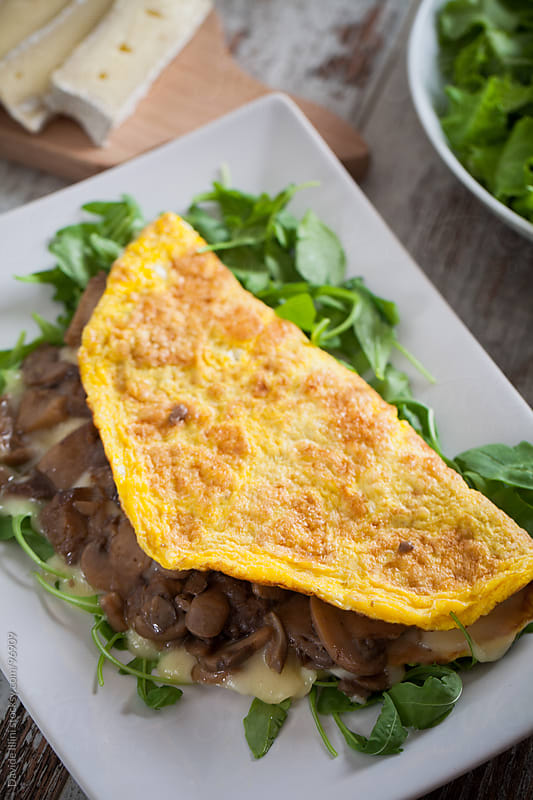 Omelette with mushrooms and cheese by Davide Illini for Stocksy United