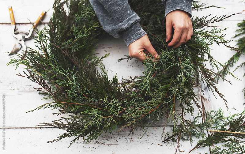 wreath making by Melanie DeFazio for Stocksy United