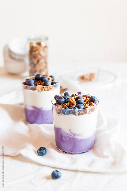 Yogurt with granola and blueberries by Nataša Mandić for Stocksy United