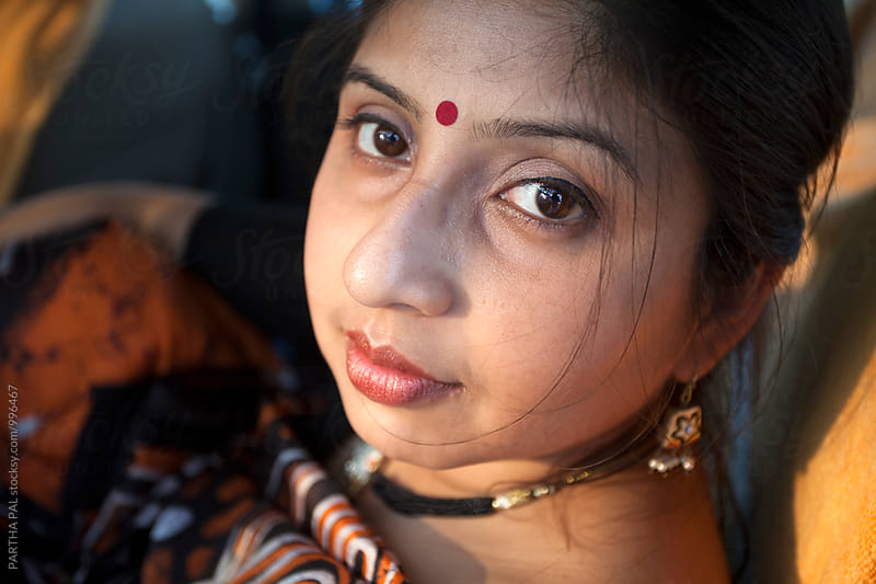 Graceful Indian woman looking at the camera by PARTHA PAL for Stocksy United