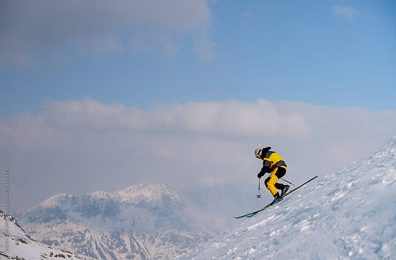 Man skiing powder snow in winter mountains by Soren Egeberg for Stocksy United