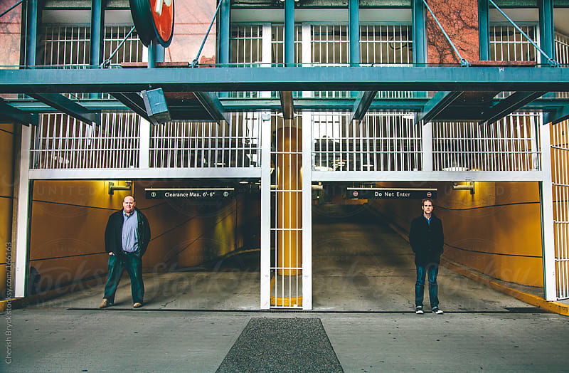 Two dudes in a parking garage. by Cherish Bryck for Stocksy United