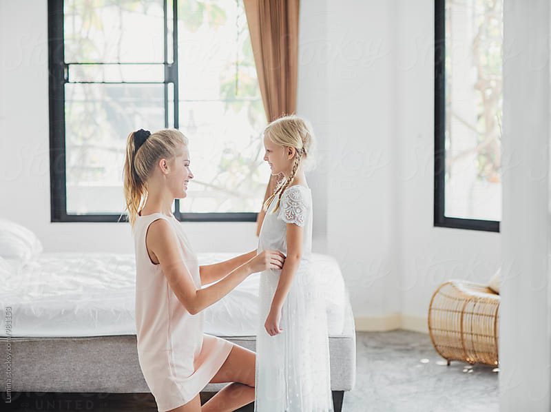 Mother and Daughter in the Bedroom by Lumina for Stocksy United