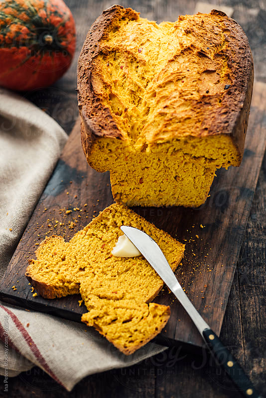 Food: Fresh homemade pumpkin bread by Ina Peters for Stocksy United