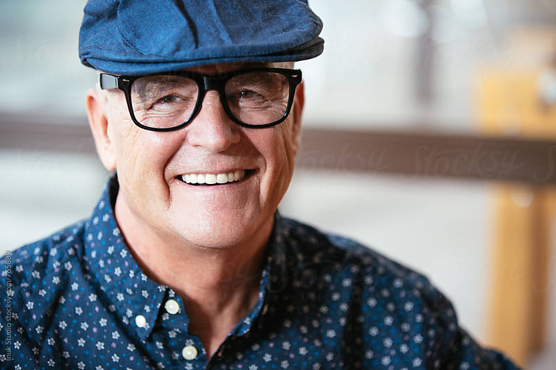 Senior stylish man portrait wearing a beret and glasses by Inuk Studio for Stocksy United