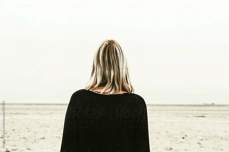 Girl on the beach, from behind - horizontal by Marija Kovac for Stocksy United
