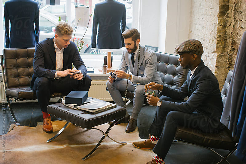 Men's Fashion - Stylish Male Tailor Showing Customers How to Fold Pocket Square by VISUALSPECTRUM for Stocksy United