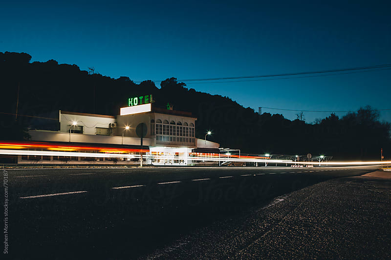 Roadside Hotel at Night in Spain by Stephen Morris for Stocksy United