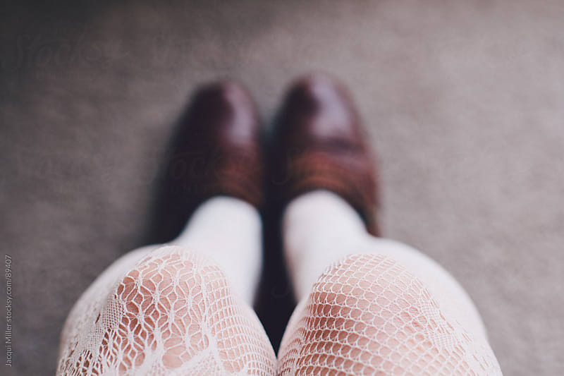 Legs in lace stockings by Jacqui Miller for Stocksy United