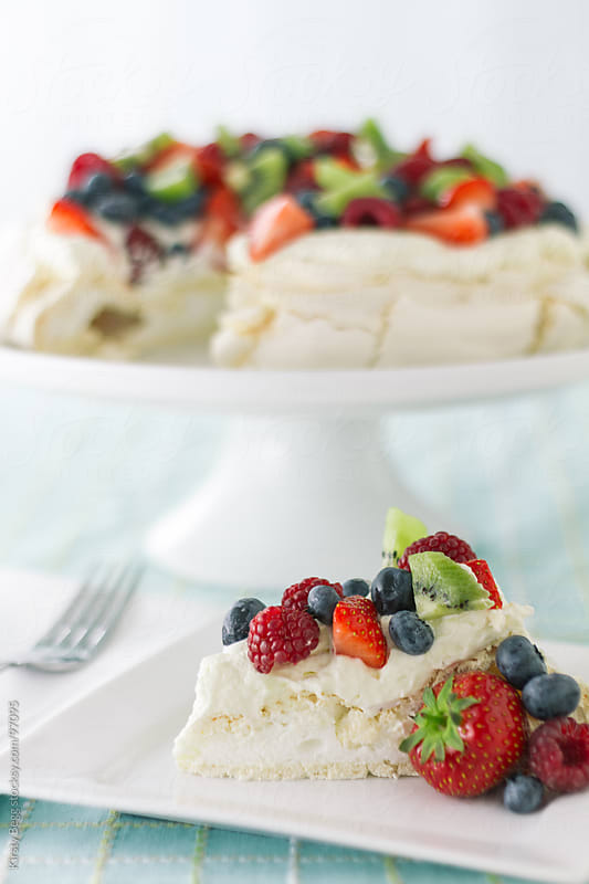 Pavlova slice with cake stand by Kirsty Begg for Stocksy United