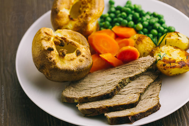 Roast beef with Yorkshire pudding, horizontal by Kirsty Begg for Stocksy United