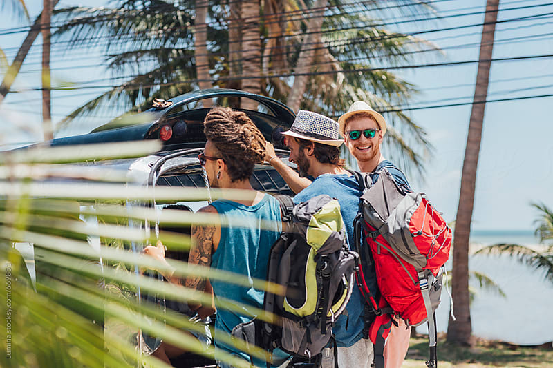 Tourists Enjoying a Taxi Ride in a Tropical Country by Lumina for Stocksy United