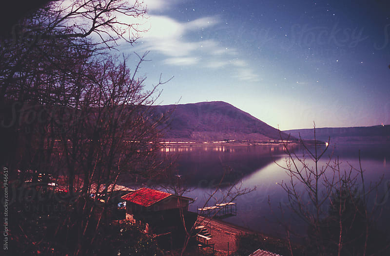 Lake at night in Italy by Silvia Cipriani for Stocksy United