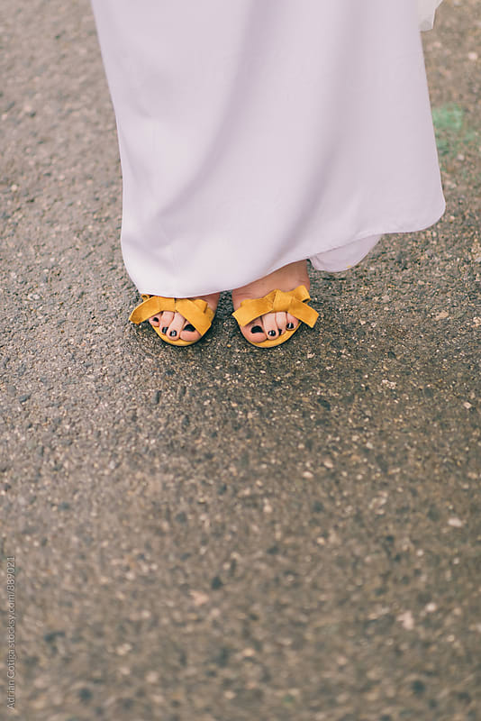 Bride's shoes by Adrian Cotiga for Stocksy United