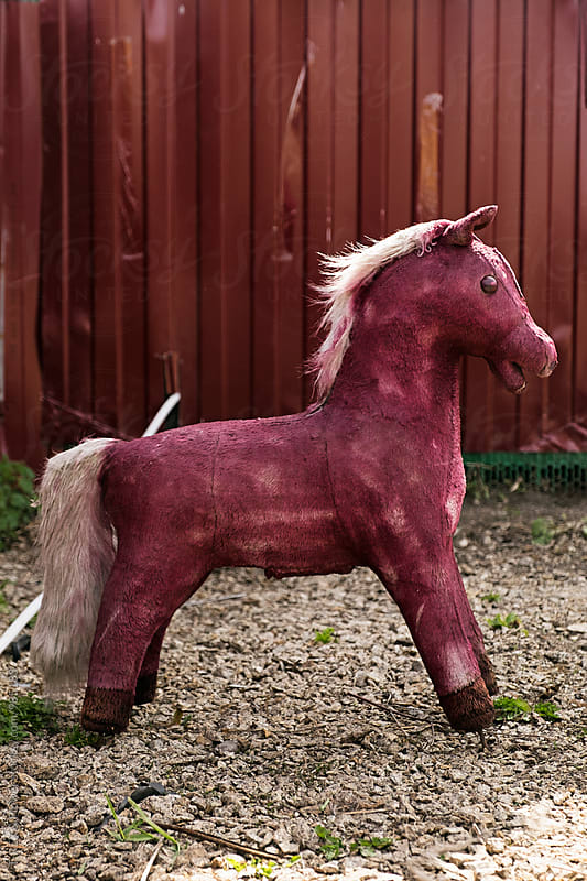 Close-up of painted purple toy horse by Danil Nevsky for Stocksy United
