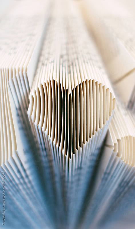 Pages of a book cut into the shape of a heart by Carolyn Lagattuta for Stocksy United