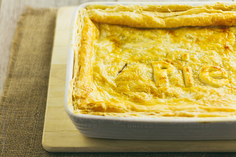 Cooked chicken pie horizontal by Kirsty Begg for Stocksy United