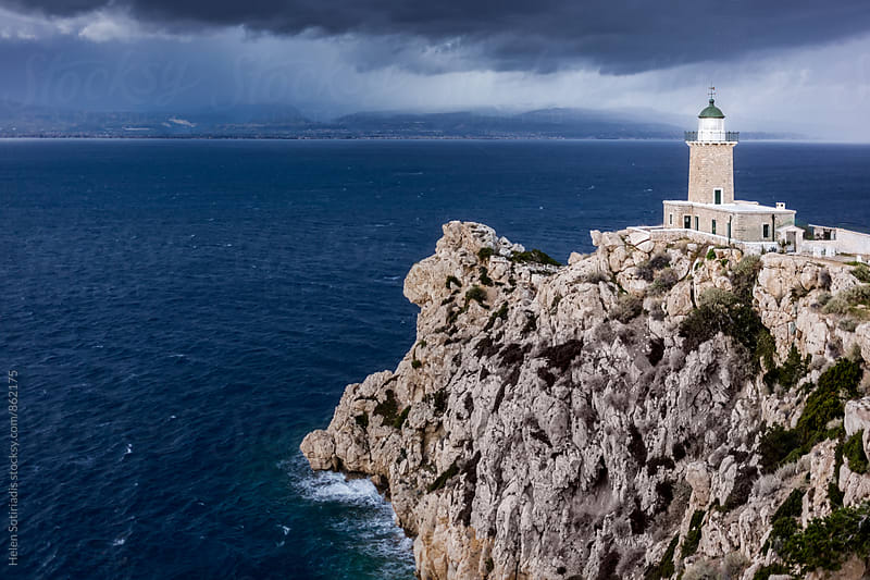 Lighthouse on a Cliff against a Moody Seascape by Helen Sotiriadis for Stocksy United