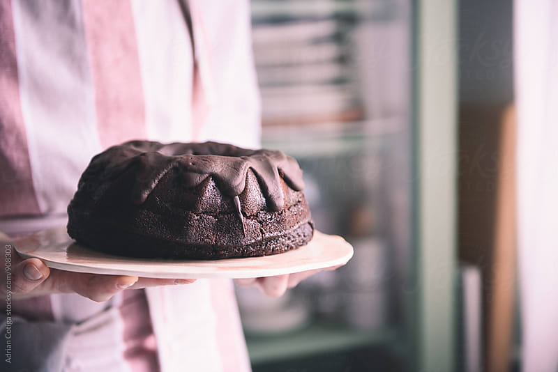 Chocolate cake by Adrian Cotiga for Stocksy United