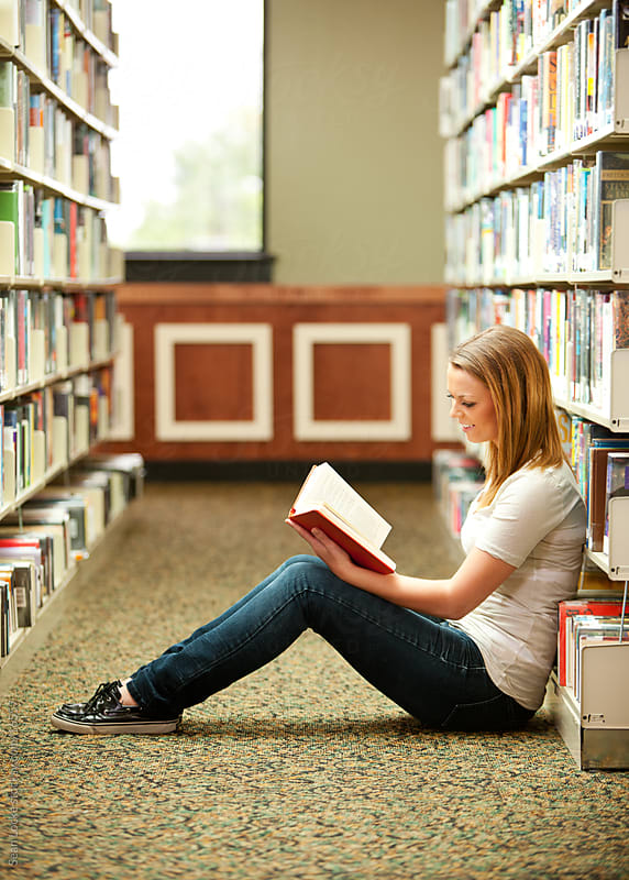 Library: Girl Sitting on Floor, Reading a Book by Sean Locke for Stocksy United
