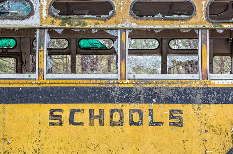 Abandoned school bus with broken windows by David Smart for Stocksy United