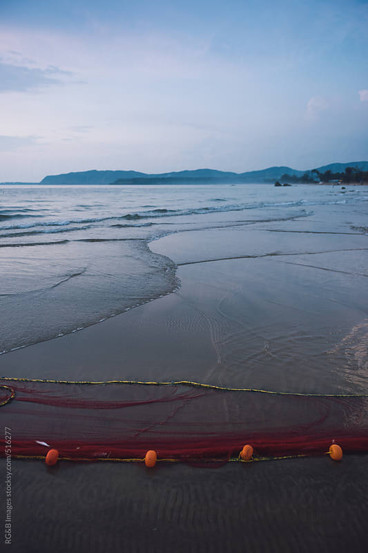 Fishing net in the water  by RG&B Images for Stocksy United