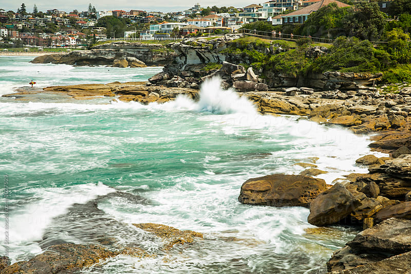 Waves Crash on Rocky Shore by Odyssey Stock for Stocksy United
