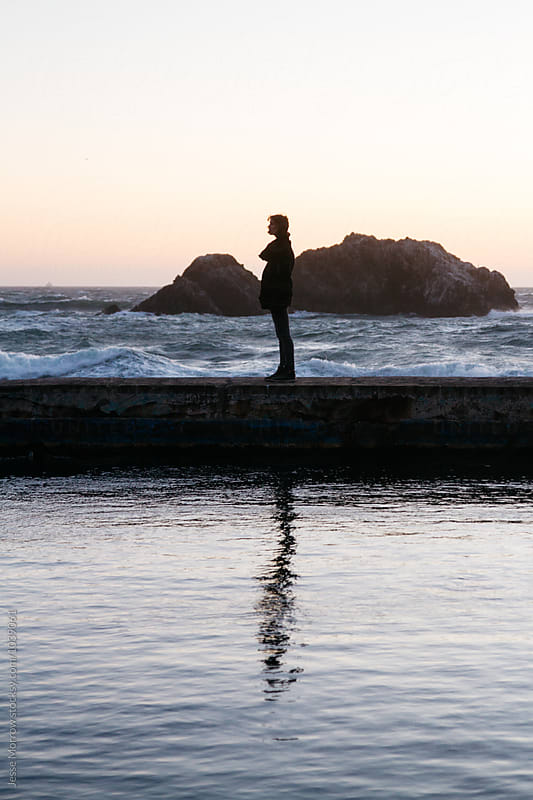 reflection of woman female at ocean during sunset by Jesse Morrow for Stocksy United