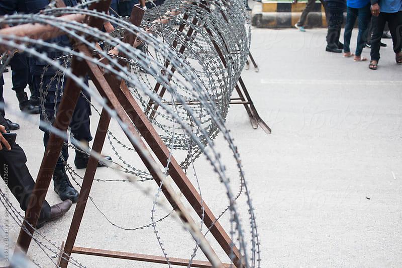 Police barricade during a protest. by Shikhar Bhattarai for Stocksy United