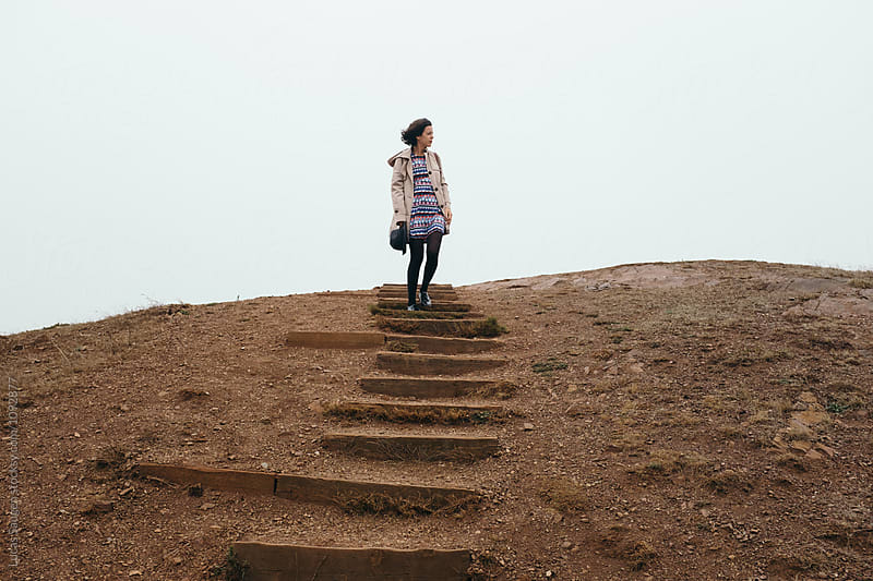 Female traveler descending steps from top of Twin Peaks lookout by Lucas Saugen for Stocksy United