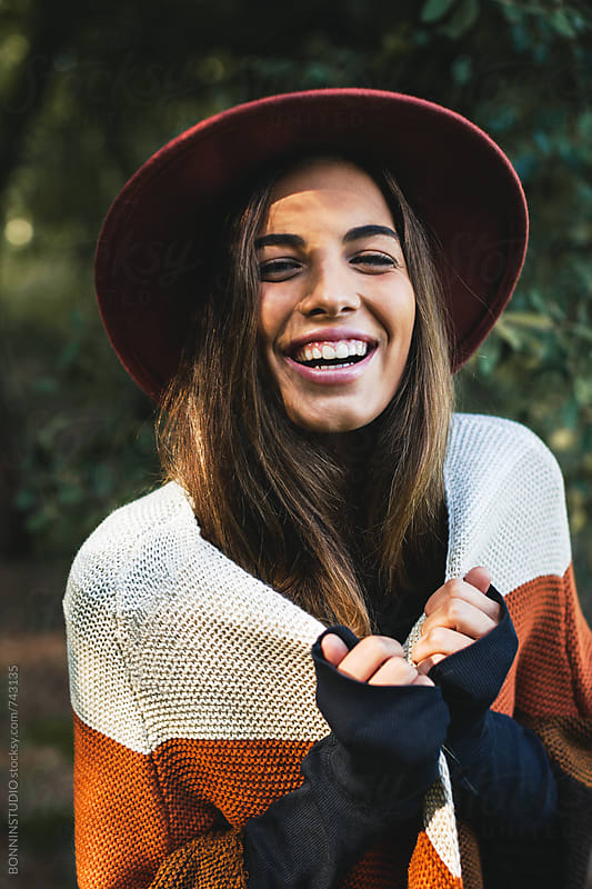 Portrait of a smiling hipster woman in the woods. by BONNINSTUDIO for Stocksy United