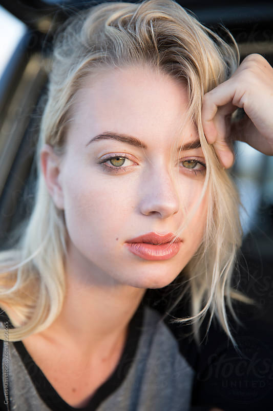 Portrait of a beautiful blonde woman by Curtis Kim for Stocksy United