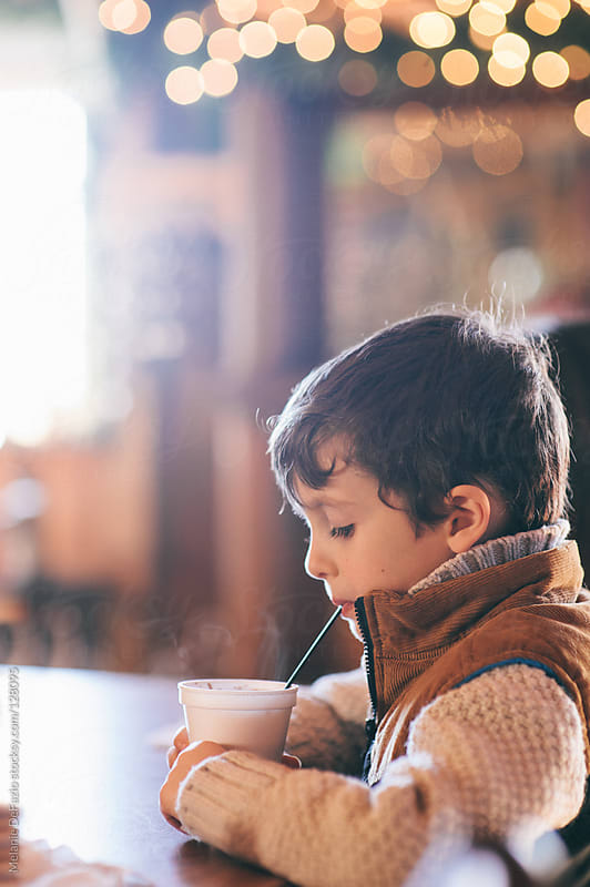 Drinking Coco by Melanie DeFazio for Stocksy United