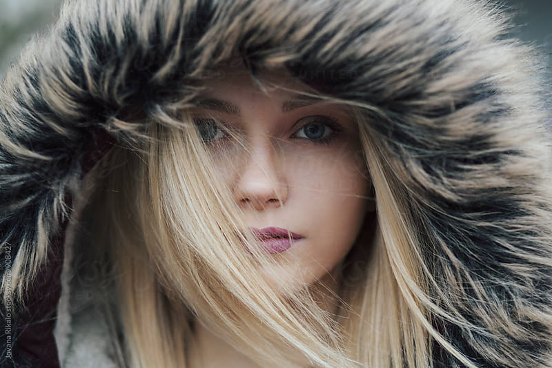 Portrait of a young woman with blue eyes by Jovana Rikalo for Stocksy United
