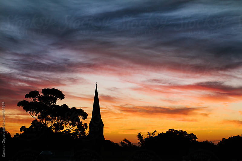 church steeple at sunset by Cameron Zegers for Stocksy United