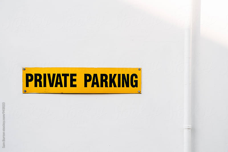 Private parking sign by Sam Burton for Stocksy United