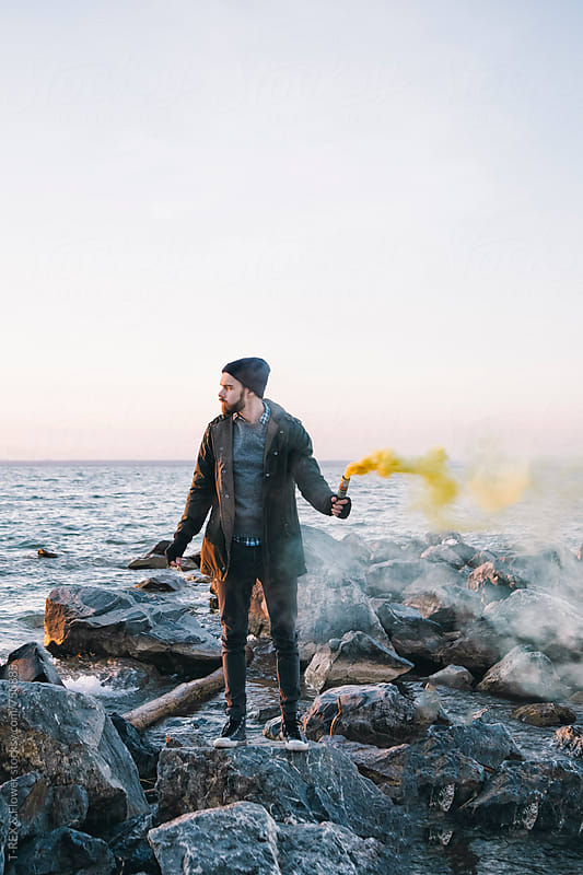 Young man standing on sea background by Danil Nevsky for Stocksy United