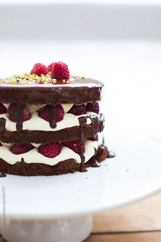 Chocolate cake with raspberries close up by Jovana Rikalo for Stocksy United