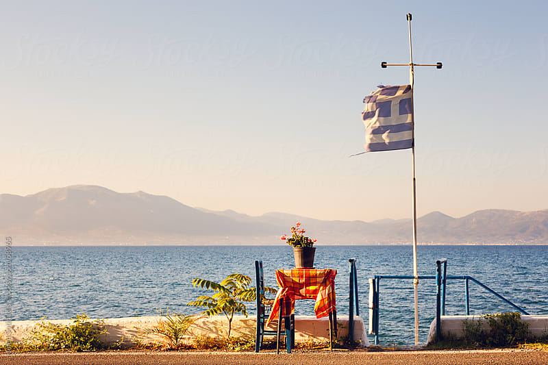 A seaside table in Greece by Helen Sotiriadis for Stocksy United