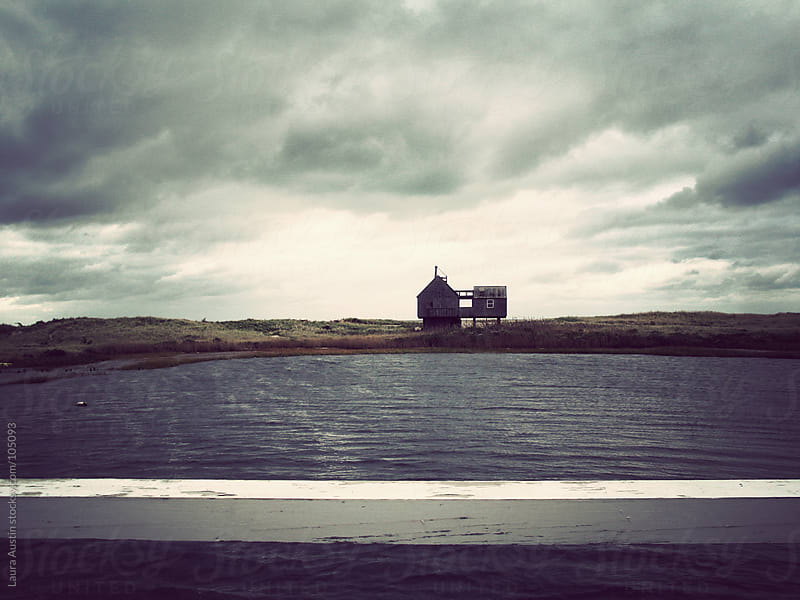 Dark Sky Over A House Along Water In Nantucket by Laura Austin for Stocksy United
