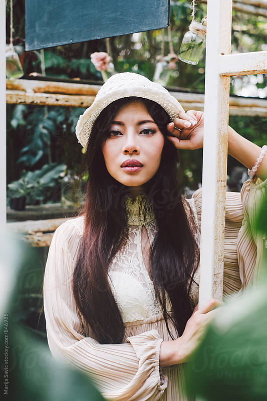 Beautiful Asian Woman in a Tropical Garden by Marija Savic for Stocksy United