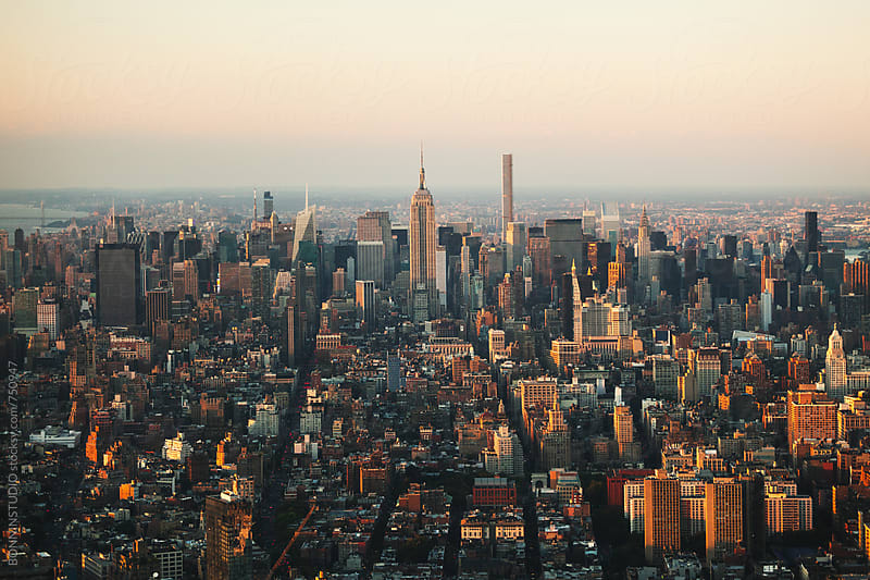 Views of Manhattan skyline at sunset.  by BONNINSTUDIO for Stocksy United
