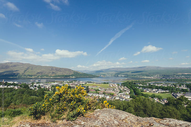 Scottish harbour town from top of a hill by Leander Nardin for Stocksy United